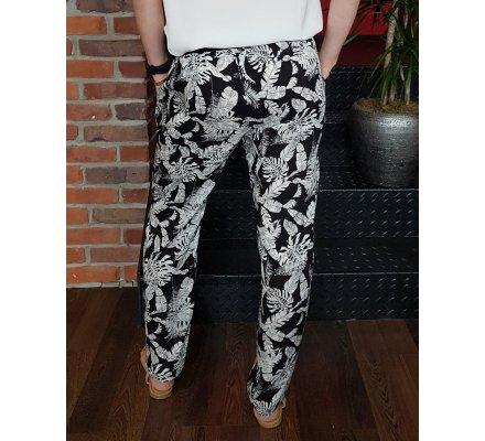 Pantalon fluide élastique noir feuillages exotiques blancs