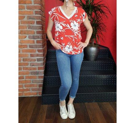 T-shirt rouge à fleurs blanches col argenté