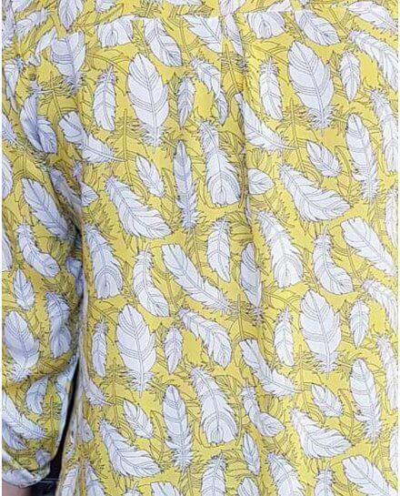Tunique jaune à plumes blanches