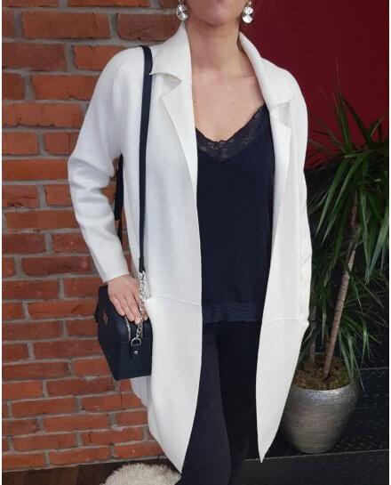 Veste blanche longue poches plaquées