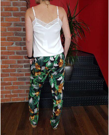 Pantalon fluide élastique noir à fleurs jaunes et feuillages verts et blancs