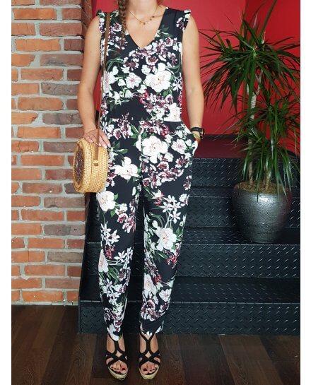 Combinaison  pantalon noire à fleurs blanches roses et vertes